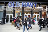 NEW YORK CITY - TUESDAY, DEC. 30, 2014: Pedestrians walk past an Old Navy store. Old Navy is a clothing and accessories retailer owned by Gap Inc.