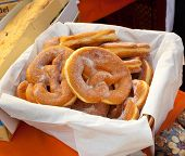 Basket Of Fried Pretzel With Sugar.