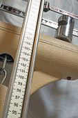stock photo of measuring height  - long measuring rod of an old Pediatric scales to measure the patients at the doctor - JPG