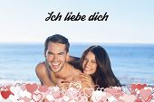 ich liebe dich against happy couple playing together