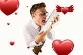 Geeky businessman licking his keyboard against hearts