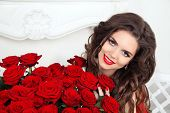Beautiful Smiling Woman With Makeup, Red Roses Bouquet Of Flowers. Fashion Girl Portrait. Valentines