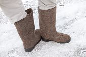 Male Feet With Russian Gray Felt Boots