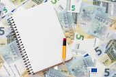 Notebook And Euro Currency