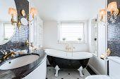 stock photo of light fixture  - Interior of black and white baroque bathroom - JPG