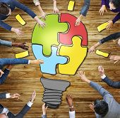foto of seminar  - Business People Light Bulb Innovation Jigsaw Togetherness Concepts - JPG
