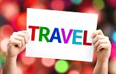 Travel card with colorful background with defocused lights