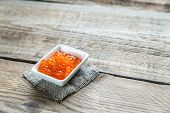 Bowl Of Red Caviar On The Wooden Table
