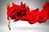 Blond Woman In Beautiful Blown Red Dress