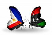 Two Butterflies With Flags On Wings As Symbol Of Relations Philippines And Libya