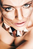 Hot Woman With Geometrical Bodyart On Face