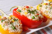 stock photo of fill  - Delicious peppers filled with rice vegetables and meat macro on a plate - JPG