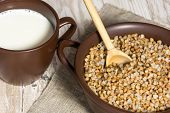 Постер, плакат: Buckwheat Cereal Milk And Wooden Spoon