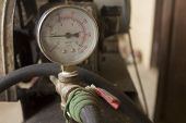 stock photo of suction  - Air compressor  meter with  old valve - JPG