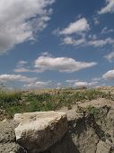 Rocky Terrain In Front Of Blue Sky With Clouds