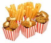 stock photo of southern fried chicken  - Southern fried chicken nuggets and French fries in red and white striped boxes - JPG