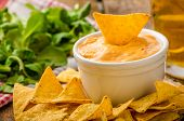 foto of dipping  - Tortilla chips with cheese dip and barbecue czech beer - JPG