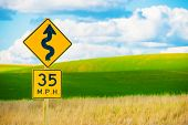 stock photo of curves  - Right Winding Road with Sharp Turn Symbol - JPG