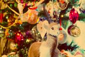 stock photo of ram  - Cute fur ram toy on background with Christmas decorations vintage photo effect - JPG