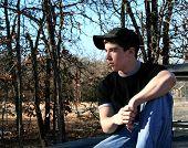 Teenage Boy Relaxing In The Woods