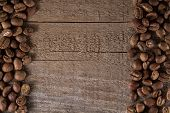 pic of brew  - roasted coffee beans on wooden table ready to brew delicious coffee - JPG