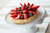 pic of custard  - Delicious homemade tartlete with custard and berries
