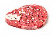 image of rib eye steak  - Close up raw beef rib eye steak with pepper and sea salt isolated on white  - JPG
