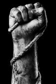 picture of gallows  - Male hand with rope on black background - JPG