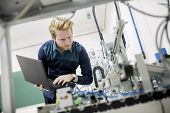 picture of mechanical engineer  - Engineer working in the lab of a factory - JPG