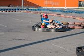 pic of karts  - Man driving fast a Kart in a circuit lap in Kharkiv - JPG