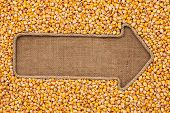image of sackcloth  - Pointer made from rope with grain corn lying on sackcloth with space for your text - JPG