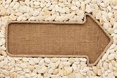picture of sackcloth  - Pointer made from rope with pumpkin seeds lying on sackcloth with space for your text - JPG