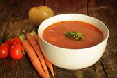 stock photo of vegetable soup  - Vegetables soup surrounded by fresh vegetables on a rustic background - JPG