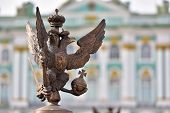 stock photo of winter palace  - Details of fence decorations with Russian Imperial Symbol of Double Headed Eagle at Palace Spuare St - JPG