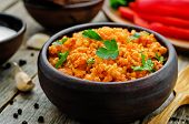 foto of millet  - millet porridge with tomato sauce garlic and parsley on a dark wood background - JPG