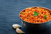 picture of millet  - millet porridge with tomato sauce garlic and parsley on a black background - JPG