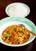 stock photo of curry chicken  - Thai red curry with chicken carrots peppers and onion - JPG