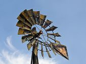 Windmill Fan and Blue Sky with Clouds