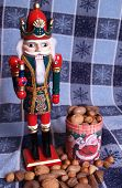 stock photo of tchaikovsky  - a nutcracker king with mixed nuts at his feet - JPG