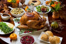 stock photo of pumpkin pie  - Roasted turkey garnished with cranberries on a rustic style table decoraded with pumpkins gourds asparagus brussel sprouts baked vegetables pie flowers and candles - JPG