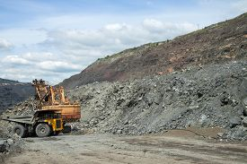 picture of iron ore  - Dump truck being loaded with iron ore on the opencast - JPG