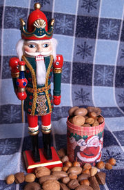 picture of tchaikovsky  - a nutcracker king with mixed nuts at his feet - JPG