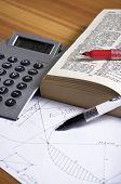 Geometry homework with calculator on wooden desk