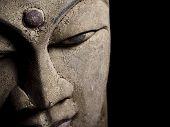 Antique Buddha head statue detail
