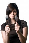 Woman Deciding Between Plastic And Reusable Forks