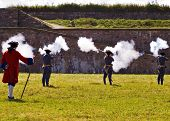 image of acadian  - louisbourg soldiers fighting a battle with muskets - JPG