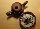 Teapot And A Bowl Of Rice