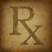 foto of prescription pad  - Rx Prescription for a pharmacist symbol in a grunge vintage look on parchement paper representing the medicine recomended by medical doctor - JPG