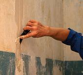 Human Arm(Hand) Repairs A Wall