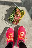 Gym foot paleo diet fitness woman taking top view picture of her ready-to-eat salad and steak lunch  poster